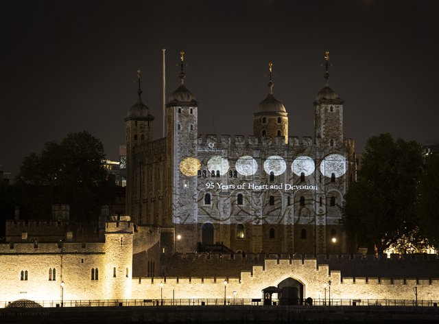 The south wall of the Tower of London bearing projected images of coins from the Queen's reign