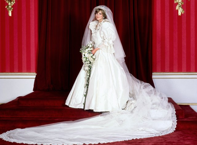 The Princess of Wales in her bridal gown at Buckingham Palace after her marriage to Prince Charles at St. Paul's Cathedral