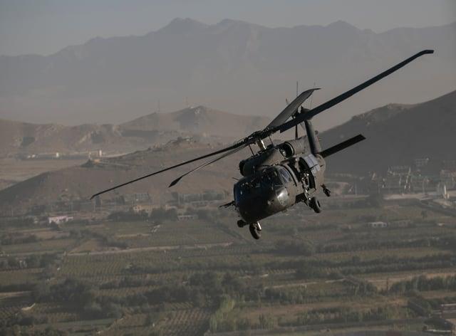 A Black Hawk helicopter over Kabul in Afghanistan (Dan Kitwood/AP)