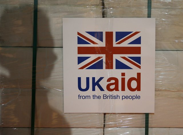 A UK aid label is attached to a box containing kitchen sets (Stefan Wermuth/PA)