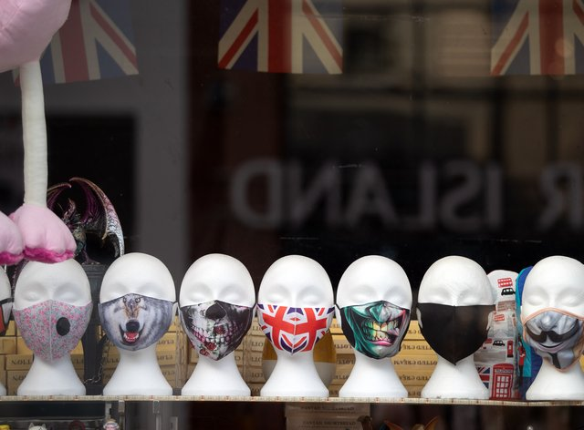 Face masks on display in a shop (Andrew Matthews/PA)