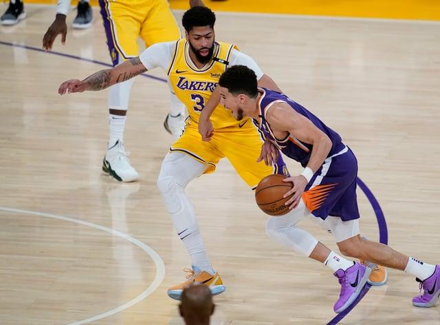 Los Angeles Lakers forward Anthony Davis defends against Phoenix Suns guard Devin Booker