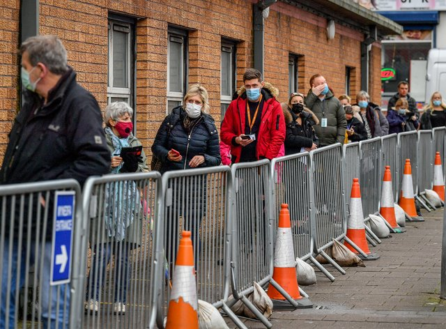 People wait for Covid vaccination