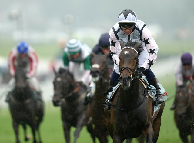 Oscula wins the Woodcote Stakes at Epsom