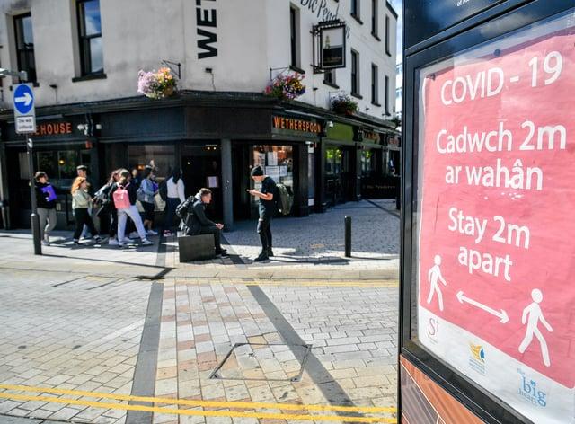 A Covid-19 poster in Merthyr Tydfil, Wales