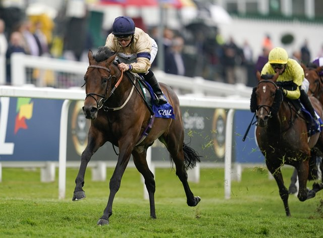 Mehmento strides to victory under Hollie Doyle in the Play Coral 'Racing-Super-Series' For Free Surrey Stakes