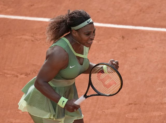 Serena Williams celebrates beating Danielle Collins
