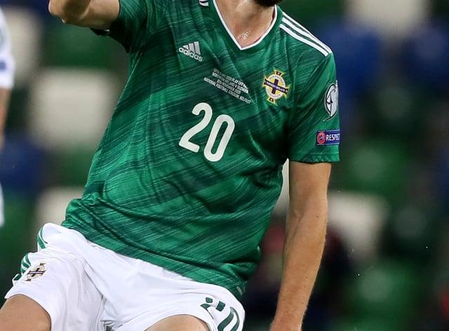 Craig Cathcart heads a ball
