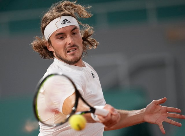 Stefanos Tsitsipas hits a forehand during his victory over John Isner