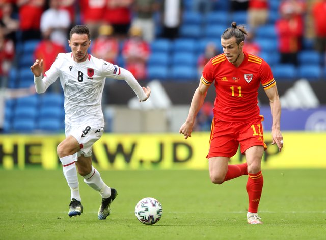 Wales' Gareth Bale, right, and Albania's Sherif Kallaku battle for the ball during their goalless draw in Cardiff
