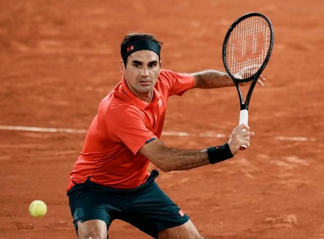 Roger Federer keeps his eye on a backhand in his win over Dominik Koepfer