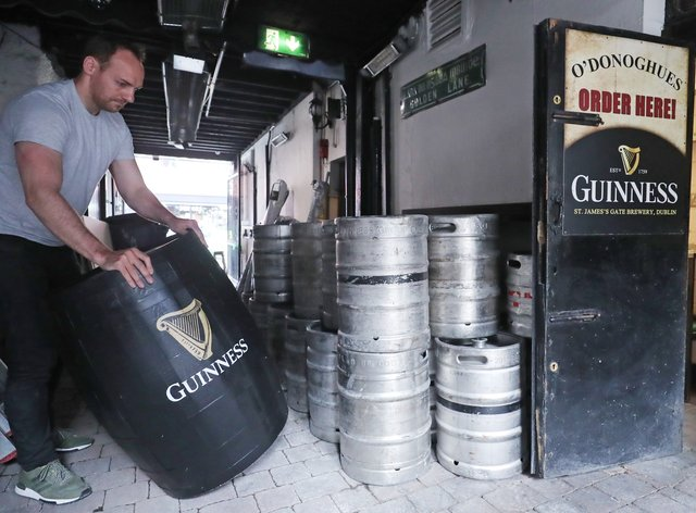 Kevin Barden sets up an outdoor drinking area at O'Donoghues Bar in Dublin