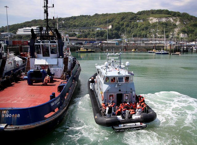 A group of people thought to be migrants are brought in to Dover