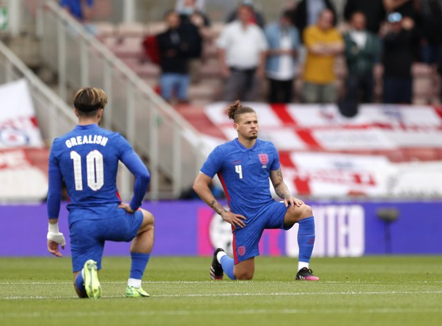 England's Jack Grealish and Kalvin Phillips take a knee before the match