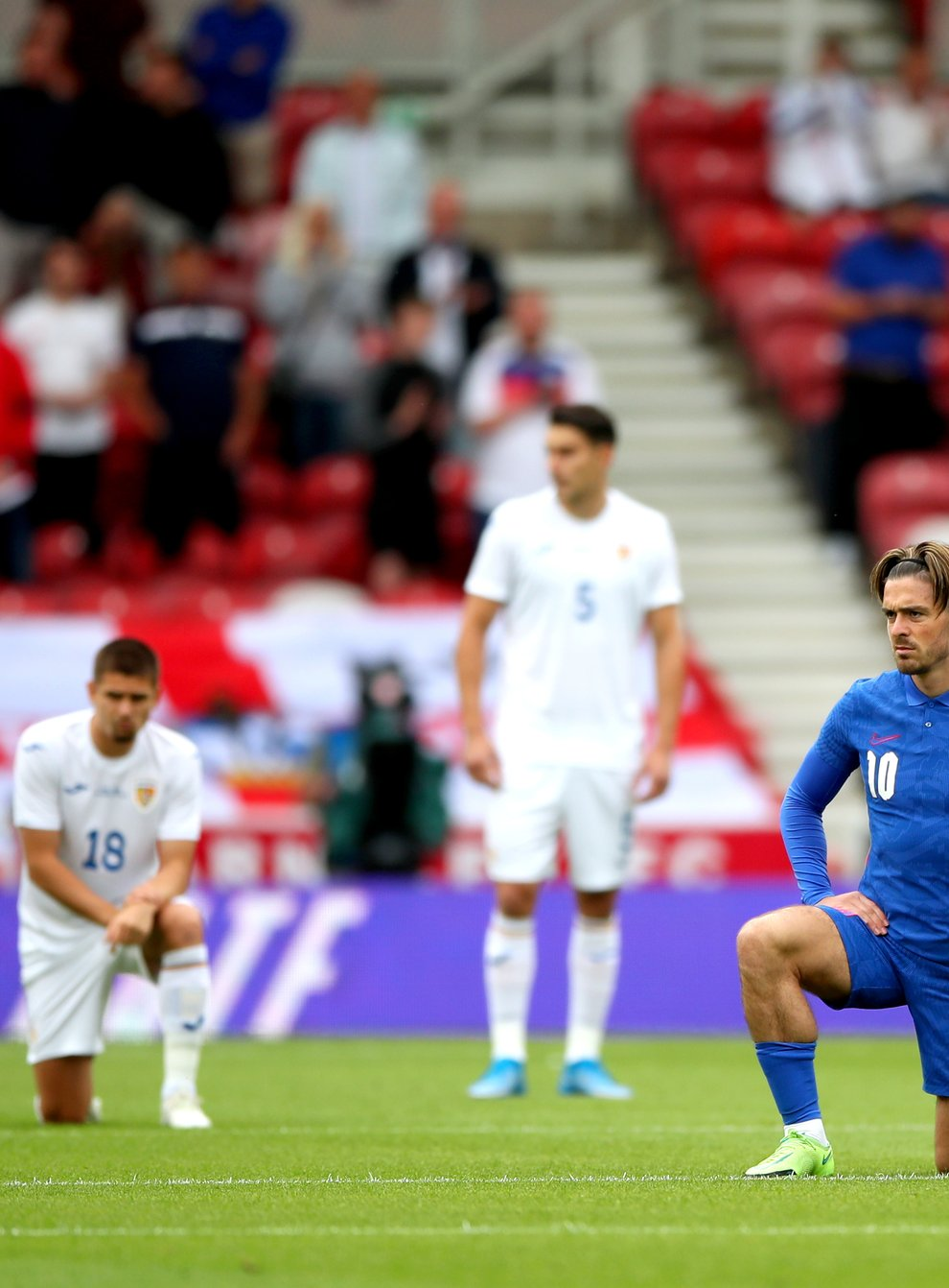 England's Jack Grealish takes a knee before their European Championship warm-up match with Romania at Riverside Stadium
