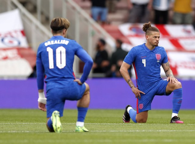 England's Jack Grealish and Kalvin Phillips take the knee before the international friendly against Romania