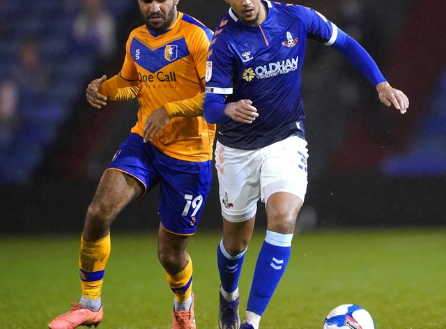 Oldham's Cameron Borthwick-Jackson (right) will join Burton when his contract expires at the end of the month