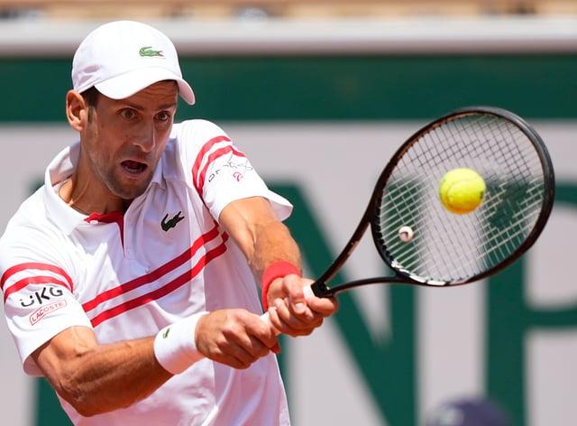Novak Djokovic, pictured, battled back to beat Lorenzo Musetti
