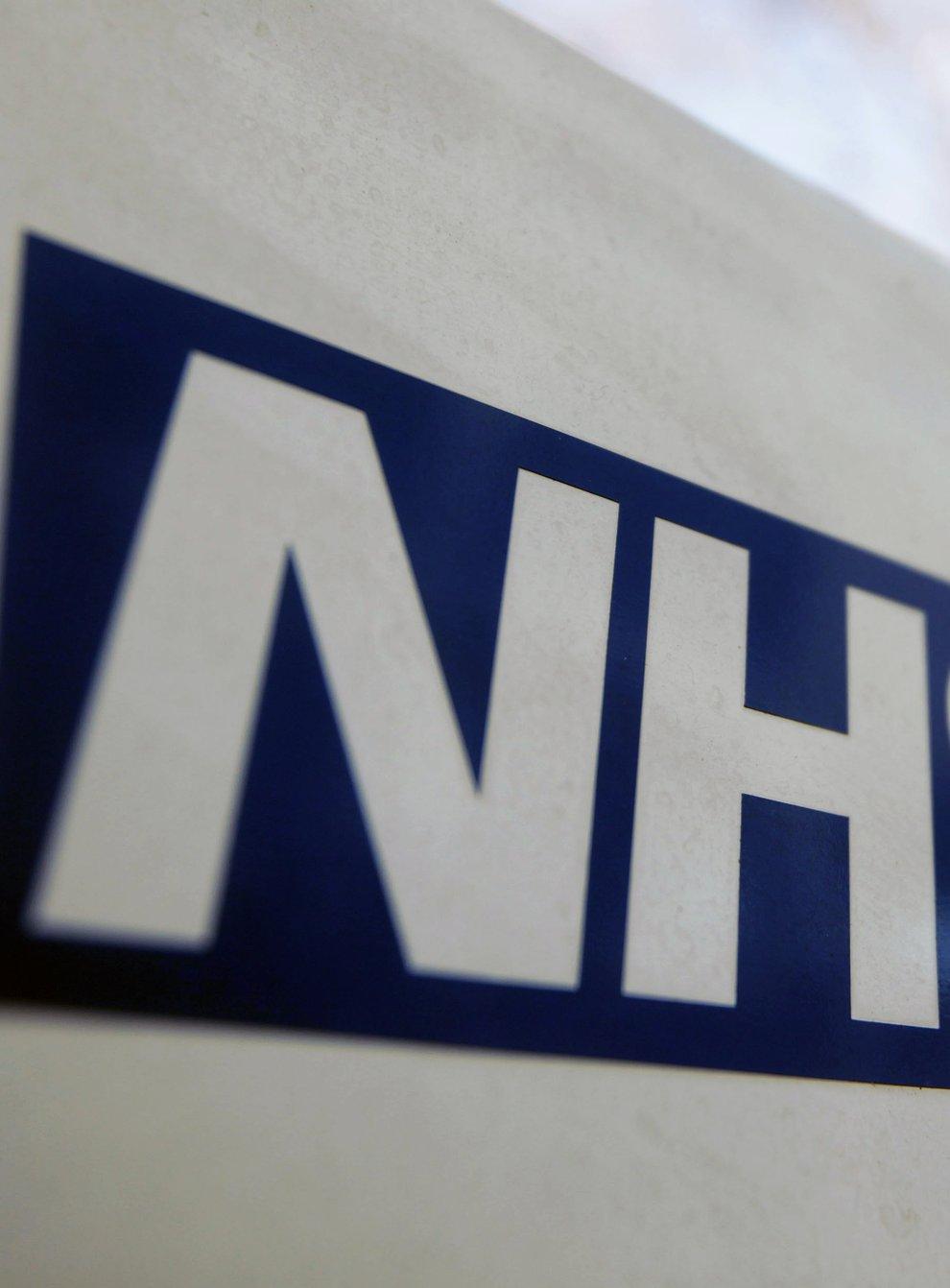 <p>An NHS sign</p>