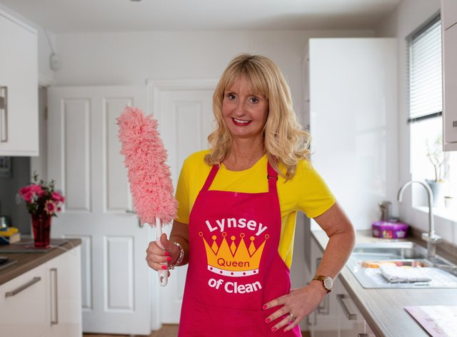 Lynsey Crombie with a feather duster (Lynsey Queen of Clean/PA)