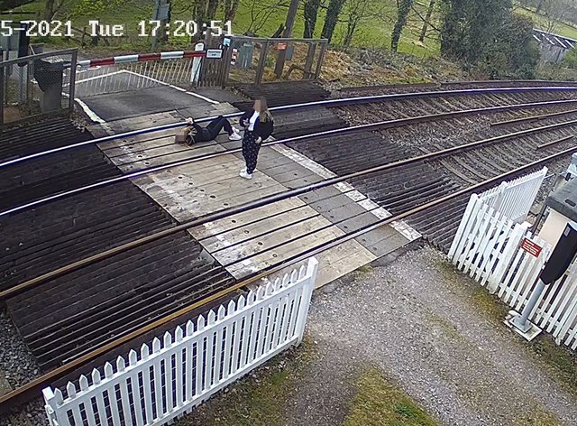<p>Girls playing on a level crossing</p>
