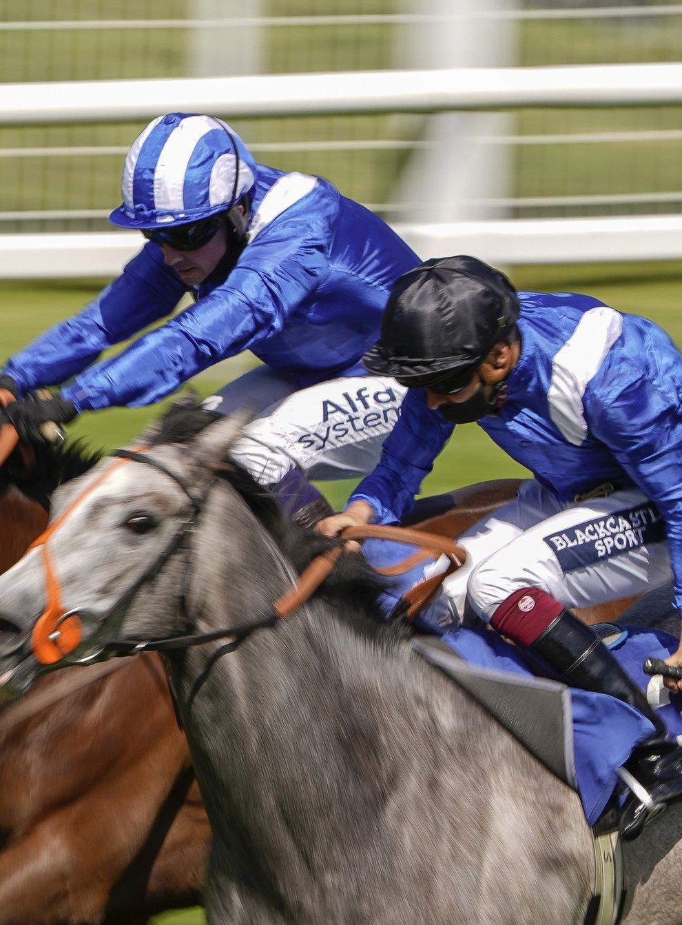 Talbeyah (left) on her way to winning at Salisbury