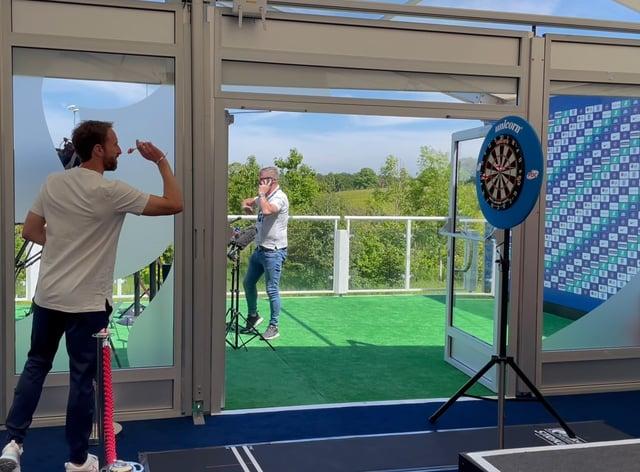 Gareth Southgate plays darts at the England media centre
