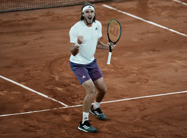 Stefanos Tsitsipas of Greece celebrates after defeating Daniil Medvedev at the French Open