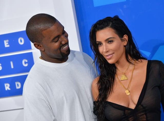 Kanye West (R) and Kim Kardashian