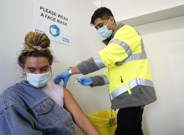 A woman receives her Covid-19 vaccination
