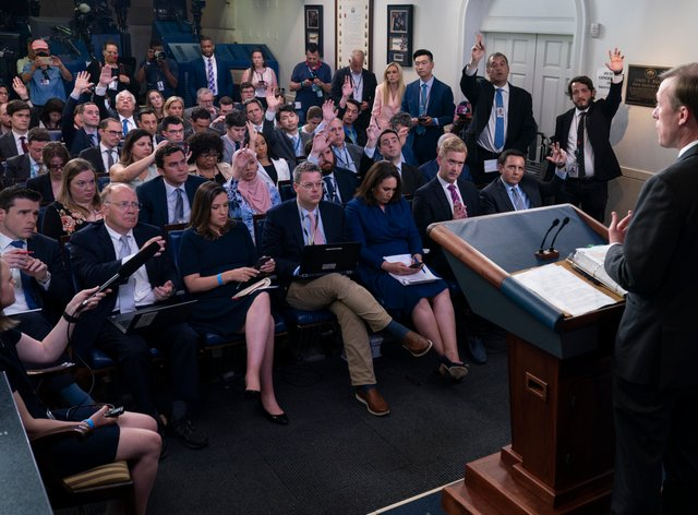 <p>Journalists raise their hands to ask a question in the White House (Evan Vucci/AP)</p>