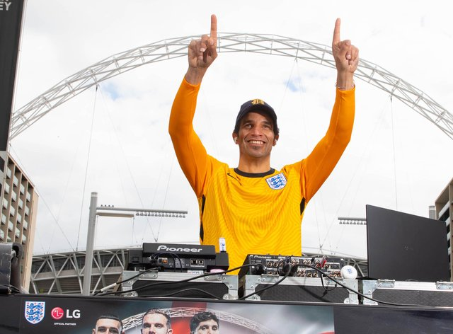 Former England goalkeeper David James points to the sky under the Wembley arch
