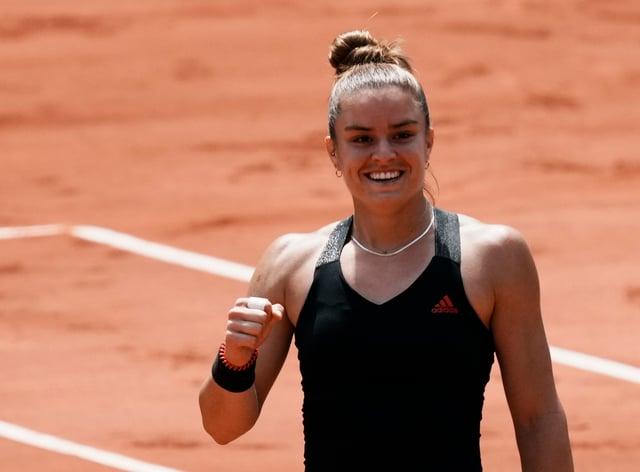 Maria Sakkari celebrates victory over Iga Swiatek