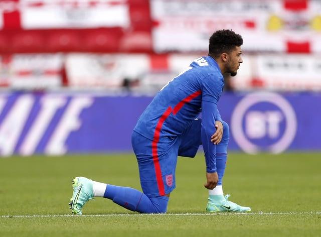 England forward Jadon Sancho takes the knee before last Sunday's match against Romania