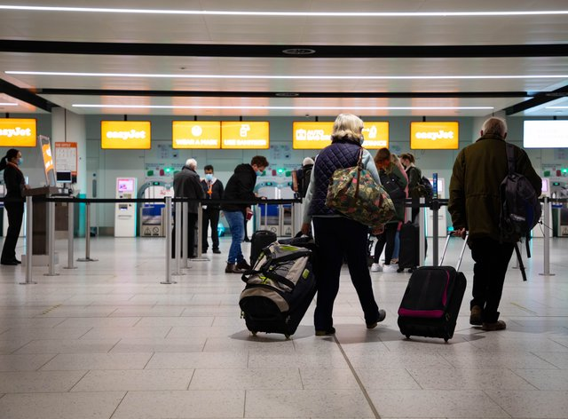 Passengers in an airport terminal