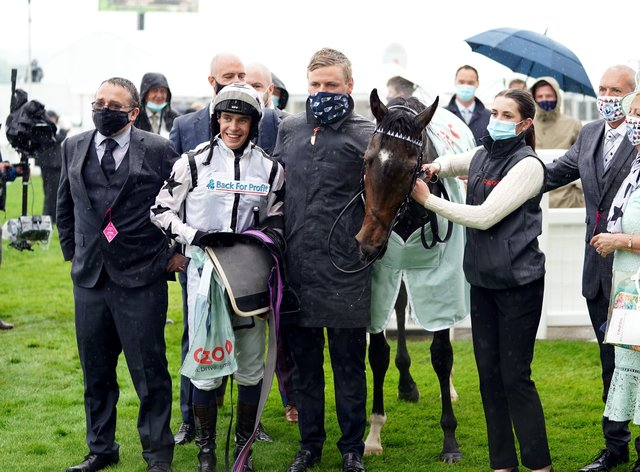George Boughey (centre) at Epsom with Oscula