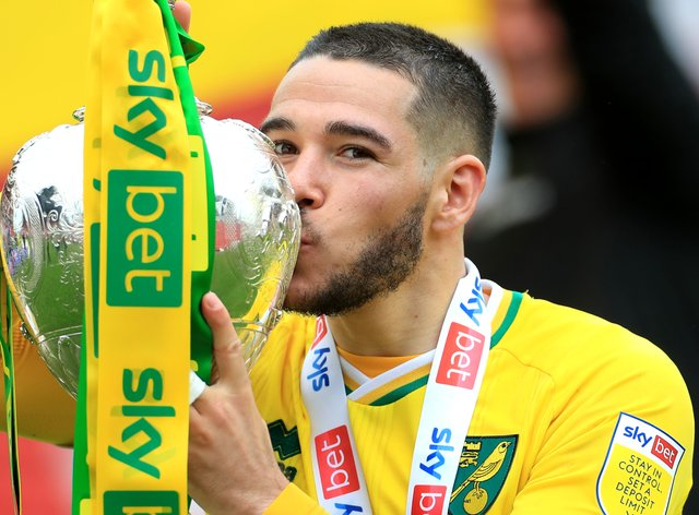 Emi Buendia celebrates with the Sky Bet Championship trophy