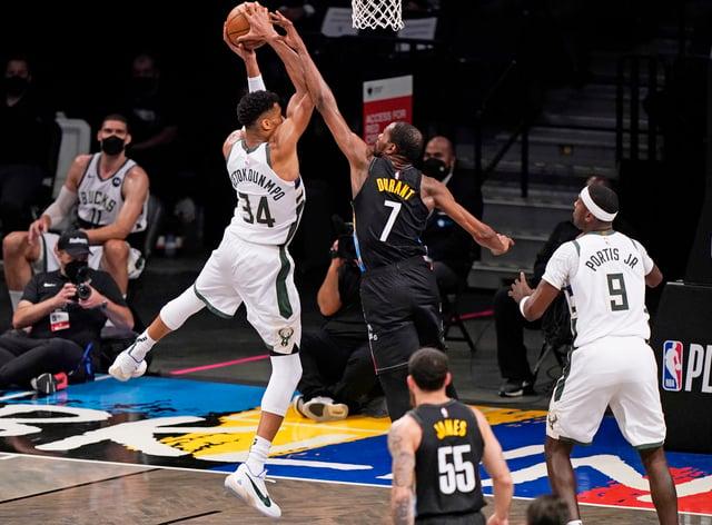 Brooklyn Nets forward Kevin Durant (7) tries to block a shot by Milwaukee Bucks forward Giannis Antetokounmpo