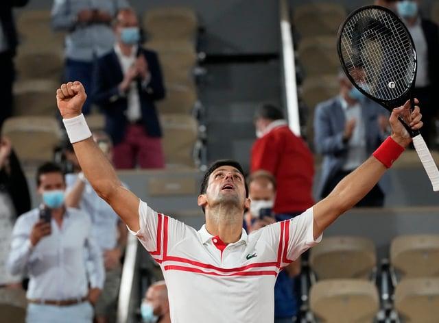 Novak Djokovic celebrates after ending the reign of Rafael Nadal