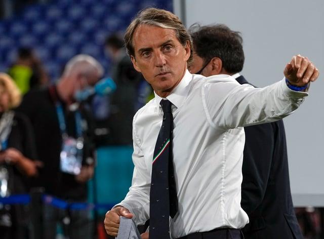 Roberto Mancini walks off the pitch at Euro 2020