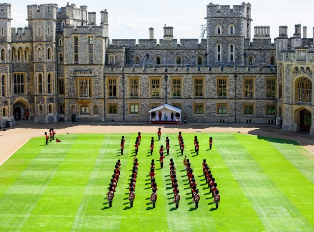 The Queen watching a ceremony in the Quadrangle of Windsor Castle