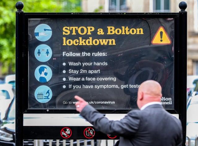 Coronavirus signage in Bolton town centre