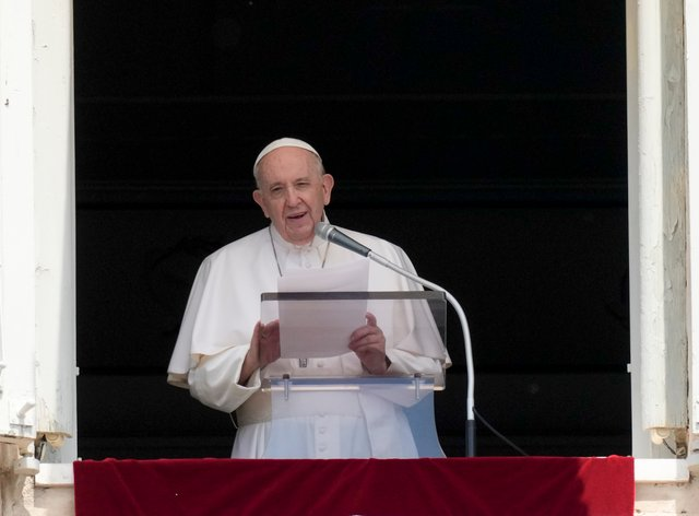 Pope Francis delivers his message during the Angelus noon prayer at the Vatican