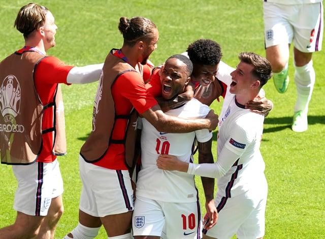 England's Raheem Sterling celebrates scoring the winning goal