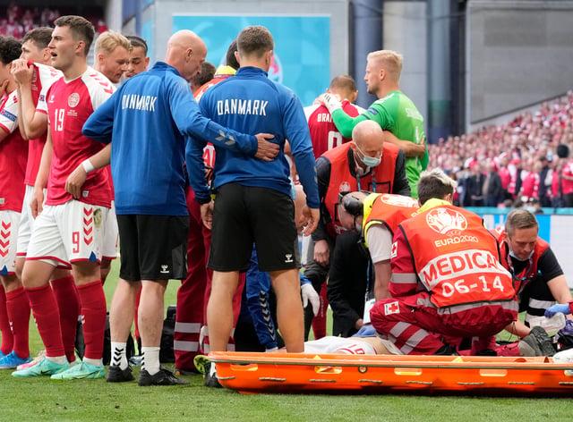 Christian Eriksen receives treatment