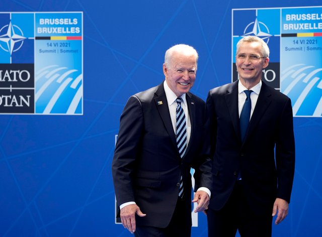 US President Joe Biden is welcomed by Nato secretary general Jens Stoltenberg