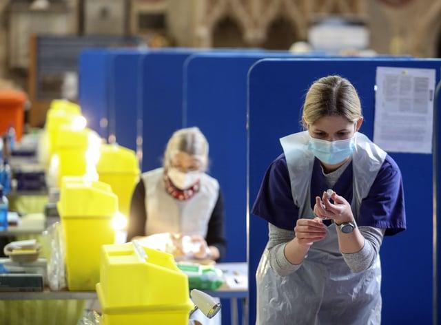Nurse prepares vaccine