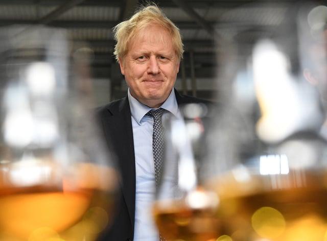 Boris Johnson at a whisky distillery