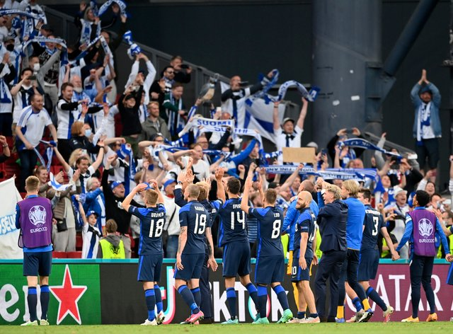 Finland players celebrate with their fans after beating Denmark in their opening group match