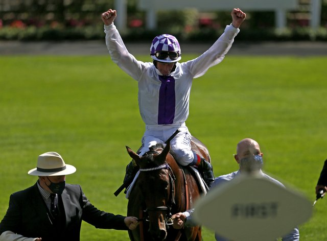 Jockey Kevin Manning celebrates Poetic Flare's breath-taking victory in the St James's Palace Stakes at Royal Ascot